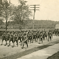Vintage photo of soldiers marching.